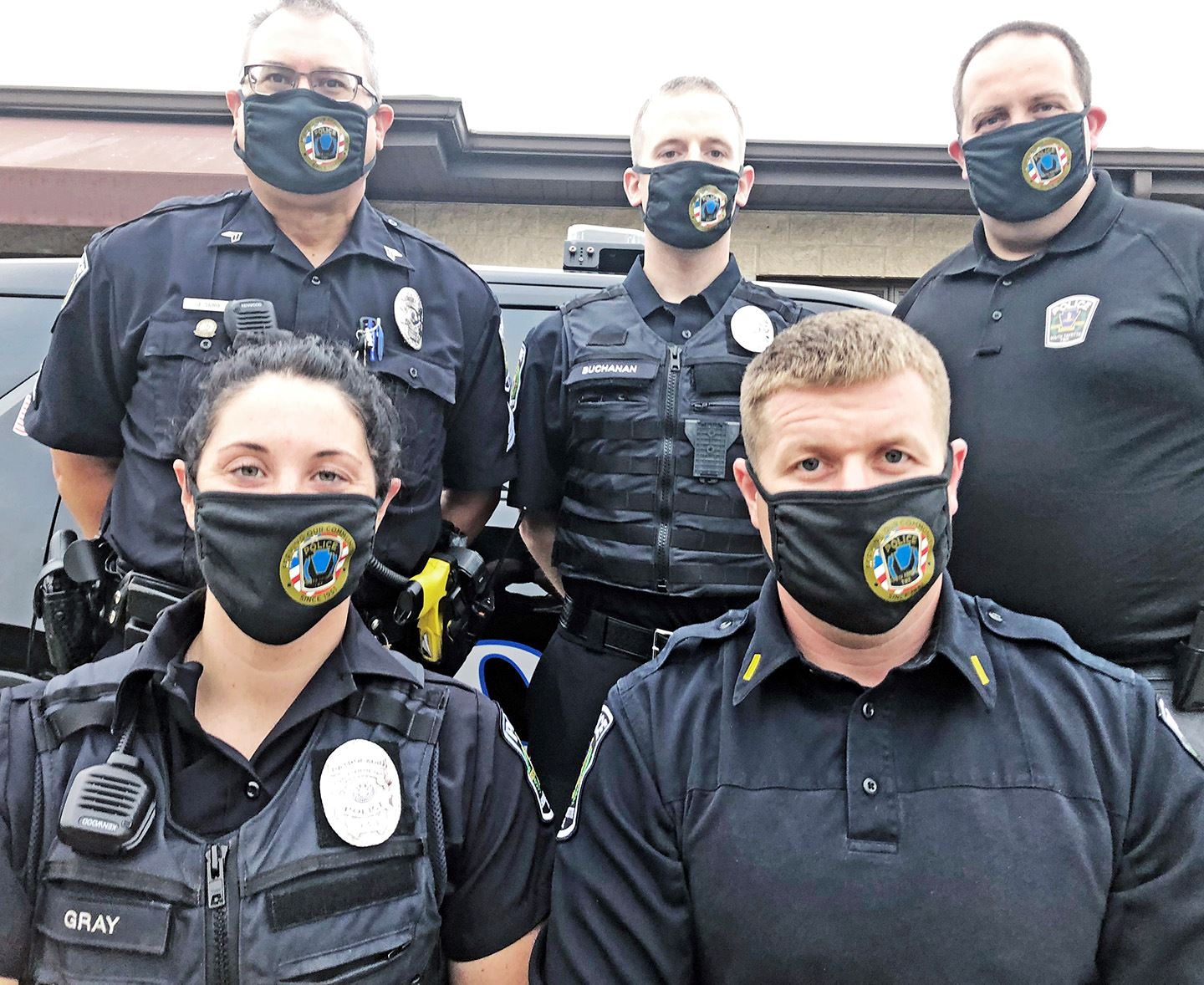 Officers wearing masks
