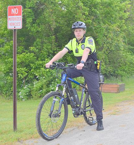 Officer Buchanan patrols the Panhandle Trail on an electric bike