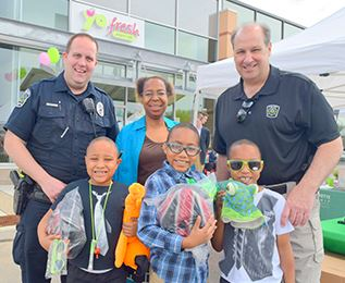 Police and children with bike helmets at Cup with a Cop event